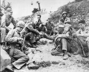 Ernie Pyle sharing with soldiers, as always...